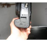 canon battery door